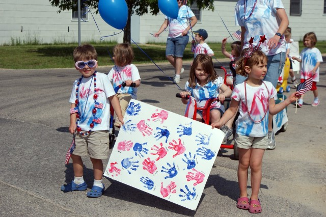 Child, Youth and School Services (CYSS) program students participate in the CYSS Army Birthday Parade at Fort McCoy, Wis., June 11. The event helped kick off Fort McCoy\'s tributes to the Army Birthday and Flag Day, which are celebrated June 14.