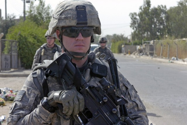 BAGHDAD - Sgt. Richard Sheetz, of Galloway, N.J., keeps an eye for any suspicious activity during a foot patrol June 13 along a major highway in the 9 Nissan district of eastern Baghdad. Sheetz, a team leader, and Paratroopers assigned to the Military Police Platoon, Brigade Special Troops Battalion, 3rd Brigade Combat Team, 82nd Airborne Division, Multi-National Division - Baghdad, conducted the clearance operation on the frequently traveled highway in Baghdad to ensure the area was free of enemy activity.