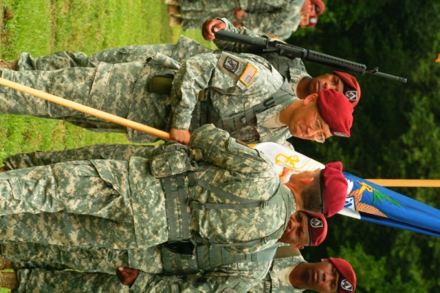 Maj. Gen. Daniel B. Allyn, XVIII Airborne Corps deputy commanding general, hands the Special Troops Battalion colors to the incoming commander Lt. Col. Peter S. Im during a change-of-command ceremony June 18 on Throckmorton Field.