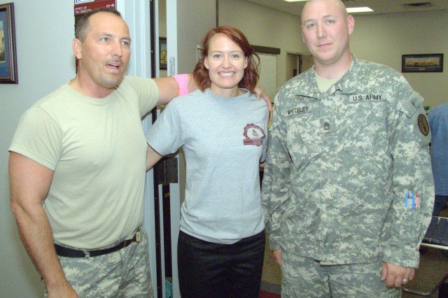 (from left) Sgt. Major Lawrence McCullar, Virginia Sanders, and Staff Sgt. Michael Whiteley pose at the Fort Hood DPW Blood Drive. All three worked together to make the drive on June 18, 2009 a success for Fort Hood.""