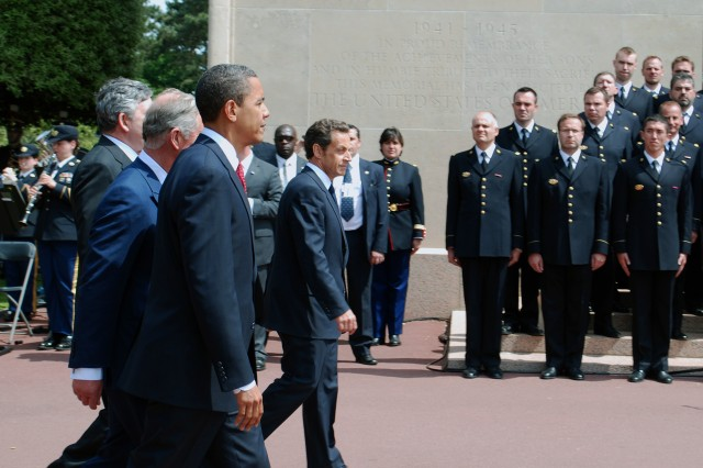 COLLEVILLE-SUR-MER, FRANCE - U.S. President Barack Obama, along with Britain's Prince Charles, British Prime Minister Gordon Brown, Canadian Prime Minister Stephen Harper, and French President Nicolas Sarkozy arrive at the American Cemetery at Colleville-Sur -Mer, France, to attend the 65th Anniversary of the D-Day landings at Normandy ceremonies here on Jun 6.