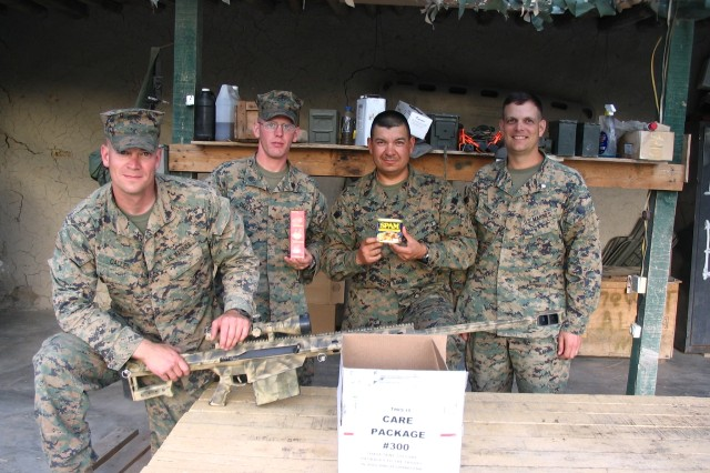 Lt. Col. Dan Yarosloski and U.S. Marine Corps ETT 27 stationed in Afghanistan receive the 300th care package sent by Don Downer.