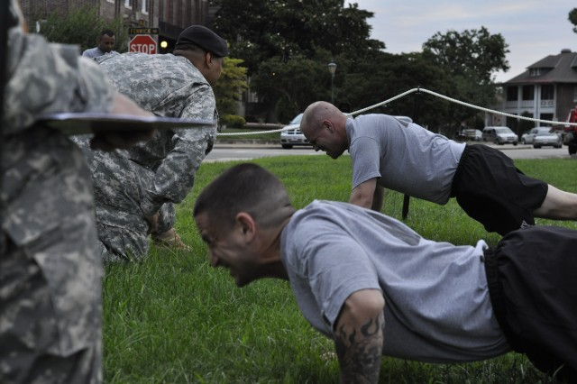 Drill sergeants, Michael Caveza and James Barrett, dig deep for the remaining seconds of the physical fitness portion of the DSOY competition, June 22, 2009 on Fort Monroe, Va.