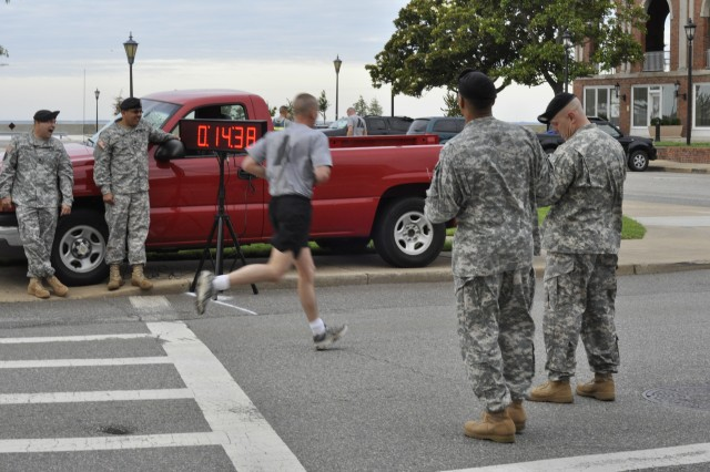 A drill sergeant finishes his 2-mile run for the physical fitness portion of the DSOY competition on Fort Monroe, Va.
