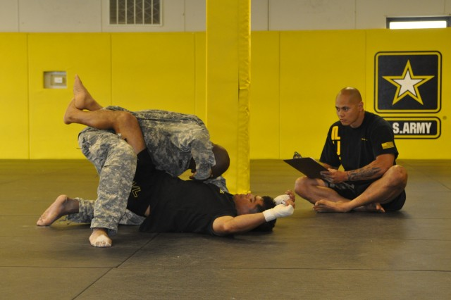 Drill Sergeant Arron Barnes simulates a combatives lesson for the DSOY competition on June 22, 2009.