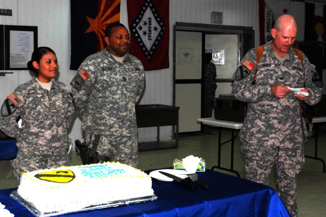 "BAGHDAD - Rockingham, N.C. native Pvt. Anahi Padilla (left), human resources specialist for Headquarters and Headquarters Troop, 1st ""Ironhorse"" Brigade Combat Team, 1st Cavalry Division and Killeen, Texas native Sgt. Maj. Robert Gilford (center), the brigade operations sergeant major, wait to cut the cake as they are honored as the youngest and oldest Soldier on Joint Security Station War Eagle, north of Baghdad, by the brigade commander, Sioux Falls, S.C. native Col. Tobin Green.  Green gave a brief history of the Army's traditions as well as the two honorees.  The ""Ironhorse"" family celebrated the Army's 234th Birthday with the official cake cutting ceremony followed by a barbeque June 14."