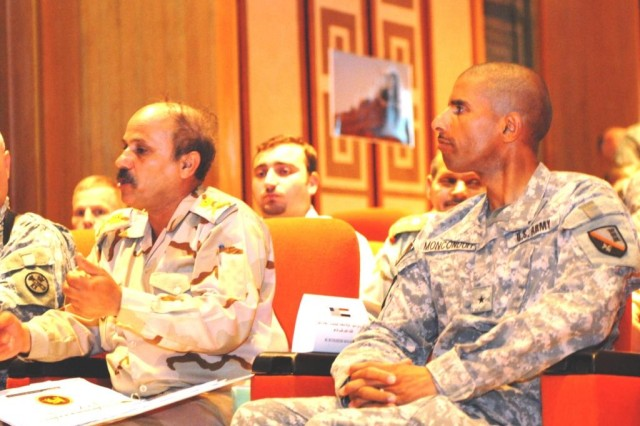 BAGHDAD - Maj. Gen. Murza Hamza (left), engineer director for the Iraqi Army answers a question posed by other Iraqi Army engineer leaders as U.S. Brig. Gen. Owen Monconduit, commander of the 225th Engineer Brigade listens, June 13 in Baghdad. The IA and U.S. engineers came together to discuss training, equipment and missions prior to the June 30th deadline for the Security Agreement.