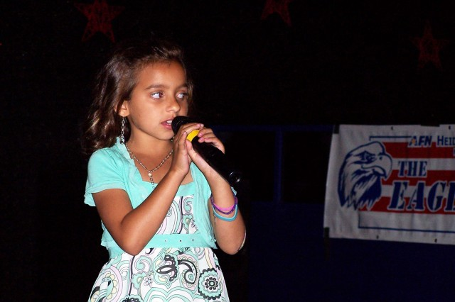 Victoria Raymond, 8, competes in the youth category of the second competition round of Mannheim Idol at the Top Hat Club Saturday. To see Victoria perform and vote for your favorite contestants, head to the Top Hat Club at 6 p.m. Saturday for round 3.