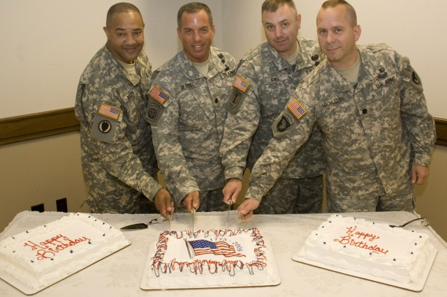 Here, left to right, Depot Sgt. Maj. Tony Butler, Lt. Col. Andrew Herbst, Lt. Col. Craig King and Lt. Col. Duncan MacMullen prepare to cut the Army birthday cakes at Anniston Army Depot.