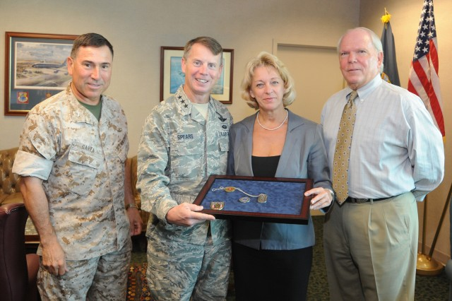 """(l to r) U.S. Southern Command Chief of Staff, Brig. Gen. David Garza, Lt. Gen. Glenn F. Spears, SOUTHCOM Deputy Military Commander, and U.S. Army Garrison-Miami Deputy Garrison Manager Michael Norman flank Marianne Winch as she displays the command coins she received in Spears' office for the exceptional quality of service she exhibited as a housing manager for SOUTHCOM's senior staff.  """"Marianne represents the SOUTHCOM Gold Standard in her approach to service to the customer, and we are very proud that she is on the SOUTHCOM Team,"""" Garza said."""