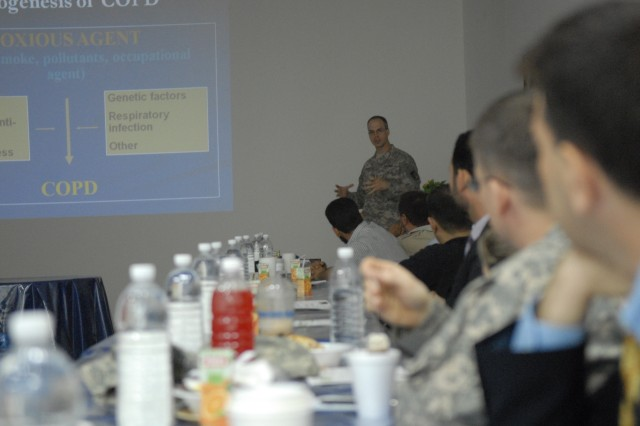 Lt. Col. Stephen Harrison, 47th Combat Support Hospital Internal medicine doctor, lectures on Chronic Obstructive Pulmonary Disease during the May medical conference at Contingency Operating Base Speicher near Tikrit, Iraq.