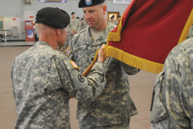 Col. Charles F. Maskell, commander of 7th Sustainment Brigade, passes the 53rd Transportation Battalion colors to Lt. Col. Corey A. New, signifying the beginning of New's time as 53rd Trans. Bn. commander during the change of command ceremony at Fort Eustis' Anderson Field House June 17.