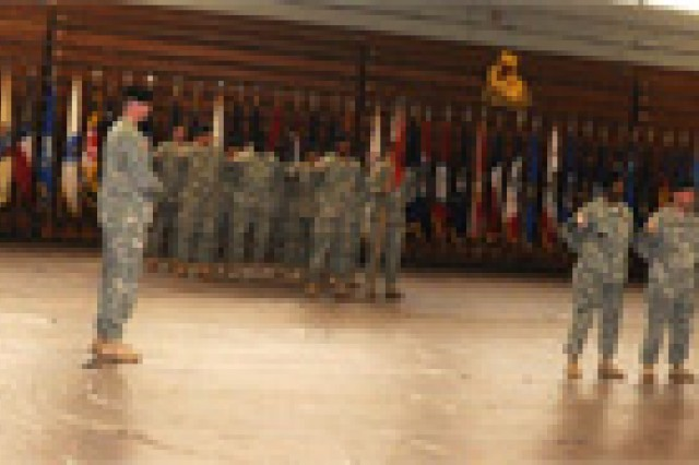 Anderson Field House's court is filled with 53rd Trans. Bn. members and Fort Monroe's Training and Doctrine Command Band to celebrate the simultaneous ending of a chapter in one man's life and the beginning of a chapter in another's life with the 53rd Trans. Bn.'s change of command ceremony.