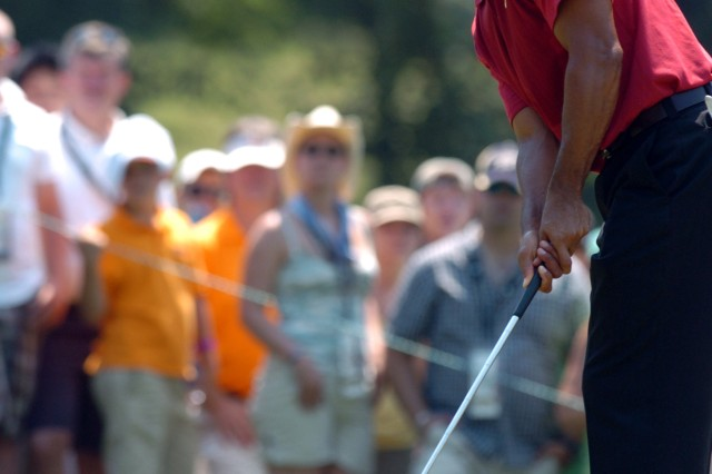 Tiger Woods, seen here putting during the 2007 AT&T National, will partner with Dallas Cowboys quarterback Tony Romo during the 2009 Earl D. Woods Memorial Pro-Am on July 1, at Congressional Country Club in Bethesda, Md.