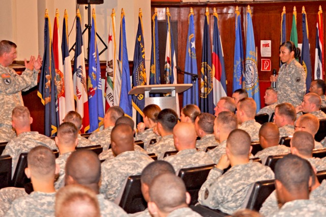 Sgt. Maj. of the Army Kenneth O. Preston answers a question during a Soldier and family forum in Wiesbaden, Germany, June 24