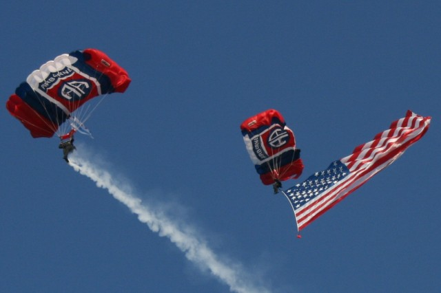 Staff Sgt. Jimmy Hackett and Sgt. Richard Sloan, members of the 82nd ABN Division All American Freefall Team, Fort Bragg, NC demonstrate their skills for about 10,000 spectators at the Chicago 2016 'Olympic Day' celebration, on Tuesday, 23 June, 2009.  Sloan is displaying the newly unveiled 750 Square Foot American Flag.