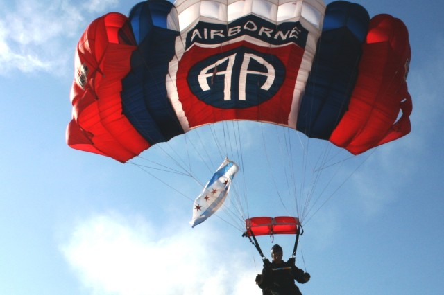 Staff Sgt. Jimmy Hackett, 82nd Airborne Division 'All American' Freefall Team, Fort Bragg, NC jumps in the City of Chicago Flag, for the Chicago 2016 Olympic Committee Celebration.  The jump was at the lakefront on Tuesday, 23 June, 2009, at North Avenue Beach with over 10,000 spectators in attendance.
