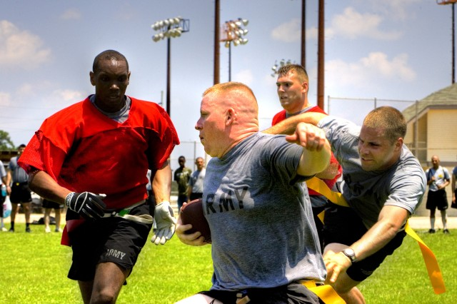 Trying to make some ground, Soldiers from 1/64 FA, 2nd HBCT, 3rd ID, play flag football in the blazing Georgia heat at Fort Stewart's Pfc. Emory L. Bennett Sports Complex during Rogue Rumble, June 19.