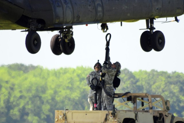 Soldiers of 1st HBCT hook a humvee to a Chinook as part of their sling-load training at Wright Army Airfield, June 19.