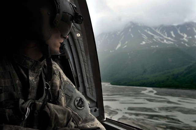 Sgt. William Penley looks over the Alaskan terrain in a CH-47 Chinook during Northern Edge 2009, June 17. Penley is a flight engineer assigned to Bravo Comany, 1-52nd Aviation Battalion, Fort Wainwright, Alaska.