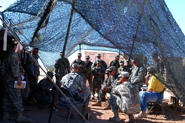 Members of the Task Force Nighthawk production control office meet to discuss maintenance, June 11, at Camp McGregor, Fort Bliss, Texas. Task Force Nighthawk was participating in their two-week iteration at Falcon Focus, a training exercise for members of the 3rd CAB, 3rd ID.