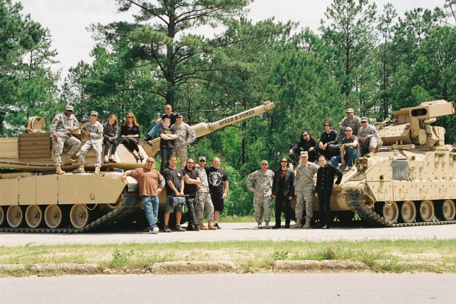 """The post welcomed Queensryche with """"open arms"""" as they gave all band members and their crew an exhilarating ride in an M1A1 Abrams tank and an M2 Bradley tank. In addition to that experience, the band dined with the troops earlier in the day and gave a concert performance on Sledgehammer Field, Kelley Hill in the afternoon."""