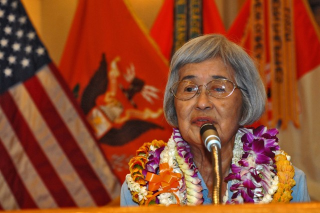 FORT SHAFTER, Hawaii - Nancy Kanbara speaks to a crowd at her retirement luncheon. Kanbara has worked as the executive secretary for the 516th Signal Brigade for 45 years, and for the federal government for 52.
