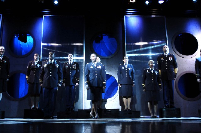 """""""Lights, Camera, Action"""" was the theme of the 2009 Soldier Show. Despite spending nearly eight months away from their units, the Soldiers never leave their military bearing and appearance, as shown in this display of their dress uniforms. The Soldiers will tour into November, performing 120 shows at 60 instillations. """""""