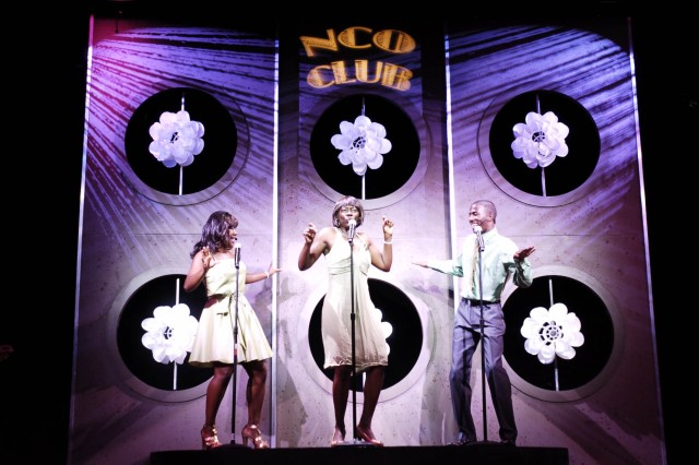 """Soldier Show cast members Staff Sgt. Nafrettifi Griffin, Chief Warrant Officer 2 Elaine Hudson and Spc. Carlos Benefield (left to right) perform during Sunday's performance for the Fort McPherson and Fort Gillem communities at the Clayton County Schools Performing Arts Center. The theme of this year's show was """"Lights, Camera, Action!"""" and contained music, dance and displays of talent from 15 Soldiers. """""""