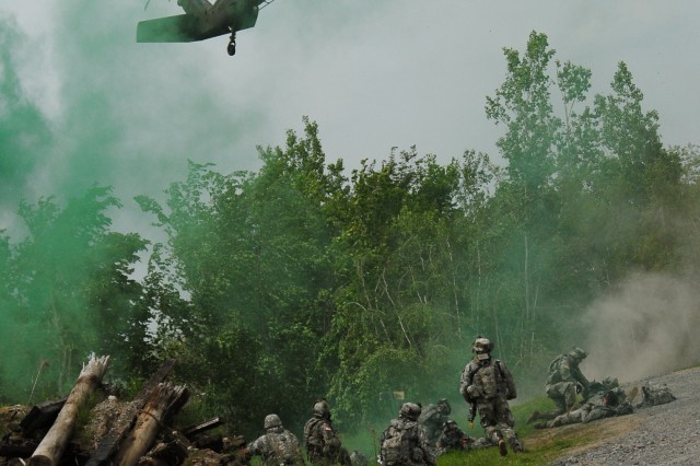 FORT DRUM, N.Y. (June 12, 2009) - Soldiers from the 2nd Battalion 22nd Infantry wait for the MEDEVAC helicopter to land. The Soldiers responded to a variety of casualties during Operation Courage Peak, the training exercise held for the battalion.