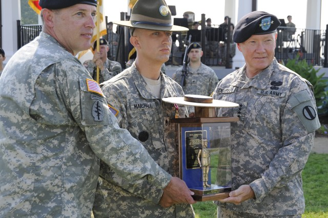 Staff Sgt. Joshua Marshall, of the 95th Division, won the Reserve 2009 Drill Sergeant of the Year title at Continental Park on Fort Monroe, Va. Marshall is presented with the Drill Sergeant of the Year trophy by Command Sgt. Maj. David Bruner and Gen. Martin E. Dempsey of the U.S. Army Training and Doctrine Command.