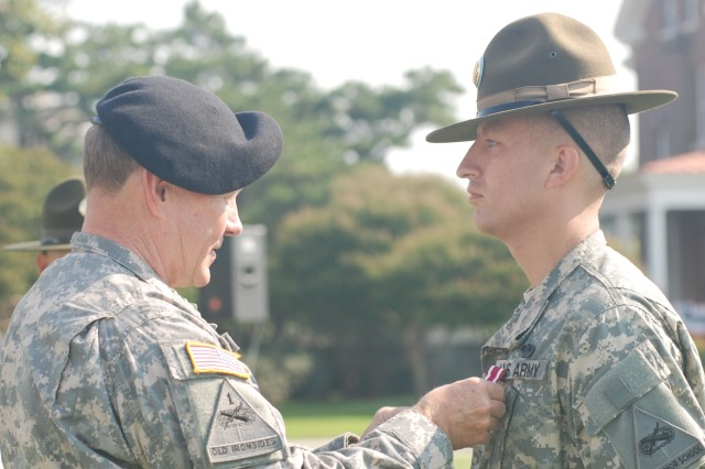 Staff. Sgt. Joshua Marshall of the 95th Division receives the Meritorious Service Medal from Gen. Martin Dempsey, commanding general of TRADOC, for winning the 2009 Drill Sergeant of the Year reserve component title.