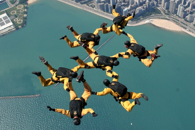 Members of the U.S. Army Golden Knights Parachute Team perform.