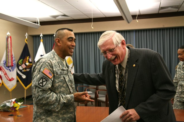 Command Sgt. Maj. Ralph Borja and Steven R. Davis, G-1 deputy chief of staff, share a laugh following the closing ceremony June 19 of the U.S. Army Space and Missile Defense Command/Army Forces Strategic Command's Army Family Action Plan Conference in Huntsville, Ala.