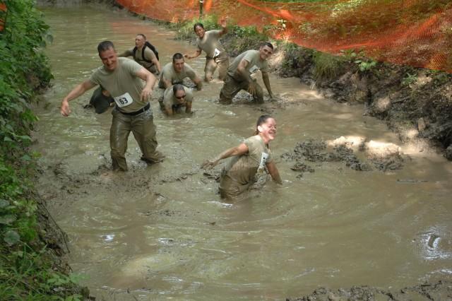 Service members work their way through the Volkslauf mud pit, Saturday.