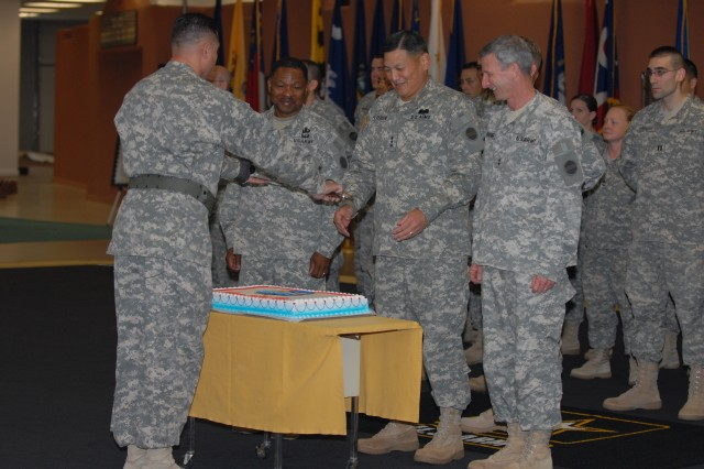 Senior leaders preparing to cut a ceremonial cake celebrating Fort Bliss' TOA