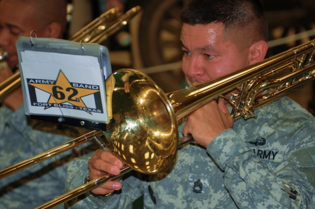 Sergeant First Class Ralph E. Garcia performs with other members of the 62nd Army Band at the transfer of authority ceremony held at the Fort Bliss Museum and Study Center June 25. (Photo by U.S. Army Pfc. Jennifer Kennemer, 16th MPAD)