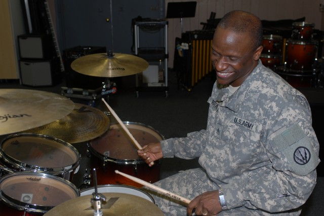 Staff Sergeant Curtis K. Ritchie finds some time for an impromptu jam session on the June 24. Ritchie has been playing with an Army band since enlisting in 1993. (Photo by U.S. Army Pfc. Jennifer Kennemer, 16th MPAD)