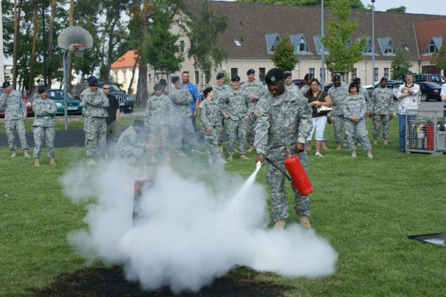 Sgt. Sean Steans, 28th Transportation Battalion, demonstrates how to extinguish an electrical fire during Fire Prevention training June 25 in Mannheim, Germany, held as part of Installation Management Command-Europe's Fire Prevention Campaign.