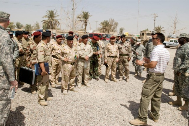 Iraqi officers listen to Soldiers brief them on supply operations during a tour of a warehouse facility run by the 419th Combat Sustainment Support Battalion at Camp Taji, Iraq, June 23. The tour was part of a meeting between 3d Sustainment Command Expeditionary officials and Iraqi commanders designed to aid Iraqis in developing their supply system.