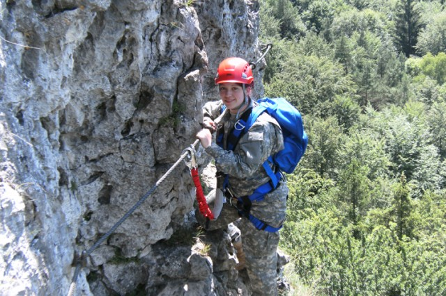 "JROTC cadet Amaris Bays, Bamberg High School, safely negotiates the ""Klettersteig"" southwest of Grafenwoehr, Germany."