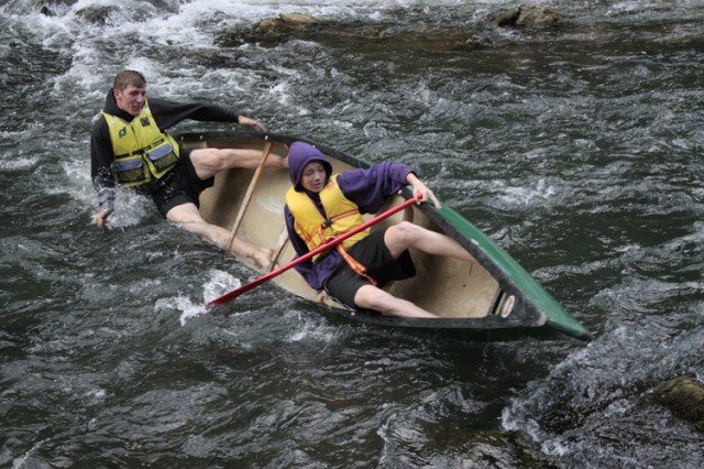 JROTC cadets Michael Niccoll, Patch High School (left) and Christian Austen, Hohenfels High School, capsize their canoe in white water on the River Wiesent, near Pottenstein, Germany.