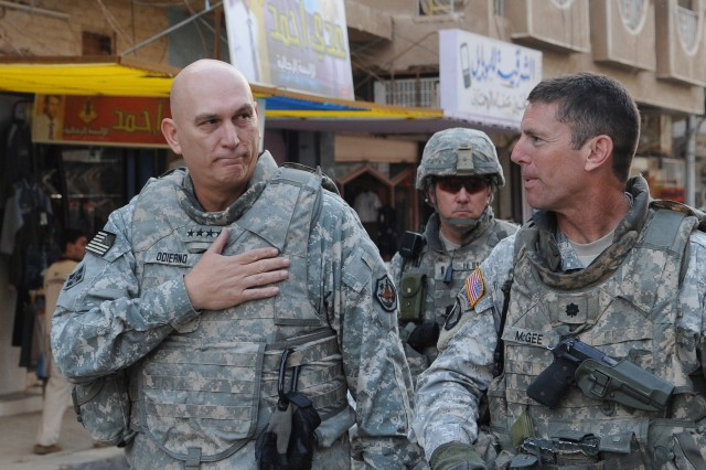 Gen. Ray Odierno, the commanding general for Multi-National Forces-Iraq, and Lt. Col. Joseph McGee, commander of  2nd-327th Infantry, 1st Brigade Combat Team, 101st Airborne Division, walk through the streets of Samarra to visit the locals in 2008. Sunday, Odierno said the U.S. has already complied with the terms of the Status of Forces Agreement, which requires that all U.S. troops to withdraw from Iraqi cities by June 30.
