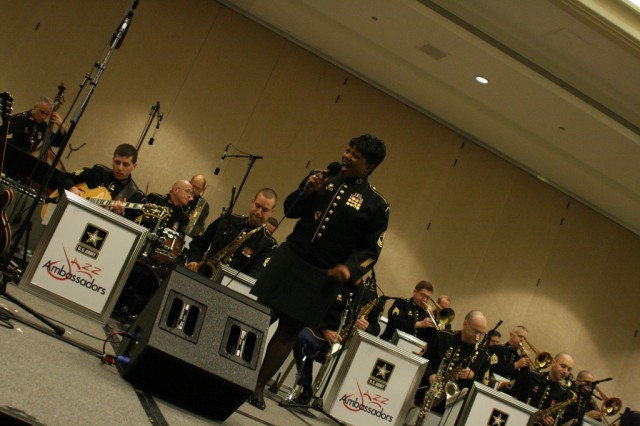 Master Sgt. Marva Lewis belts out a tune during a Jazz concert to entertain participants at MENC's Music Education Week conference in Washington, D.C.