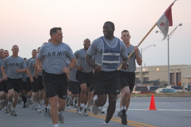 "Major Gen. Michael Ferriter, Commanding General, Fort Benning, Ga. (left), talks with Cpt. Issac Henderson, Commander, Troop B, 3rd Squadron, 1st Cavalry Regiment, 3rd Heavy Brigade Combat Team, 3rd Infantry Division, during a troop run.  Ferriter, who is marking his fifth tour at Fort Benning, joined the ""Dog-Faced Soldiers"" for a morning run before receiving a brief from the 3rd Brigade staff on June 29."
