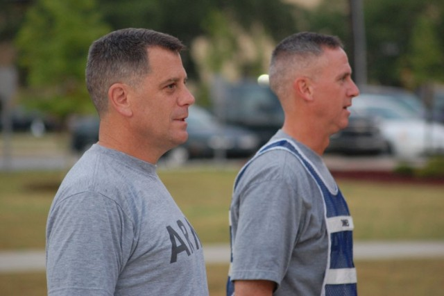 "Major Gen. Michael Ferriter, Commanding General, Fort Benning, Ga. (left), joins Col. Peter Jones, Commander, 3rd Heavy Brigade Combat Team, 3rd Infantry Division, in a division ritual: the singing to the ""Dog-Faced Soldier Song.""  Ferriter, who took command of Fort Benning June 24, joined the Soldiers of Troop B, 3rd Squadron, 1st Cavalry Regiment for a morning run before receiving a brief from the 3rd Brigade staff on June 29."