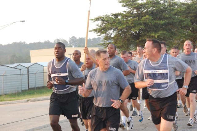 "Major Gen. Michael Ferriter, Commanding General, Fort Benning, Ga. (center), talks with Lt. Col. Christopher Kennedy, Commander, 3rd Squadron, 1st Cavalry Regiment, 3rd Heavy Brigade Combat Team, 3rd Infantry Division, during a troop run.  Ferriter, who took command of Fort Benning June 24, joined the ""Dog-Faced Soldiers"" for a morning run before receiving a brigade activity brief from the staff on June 29"