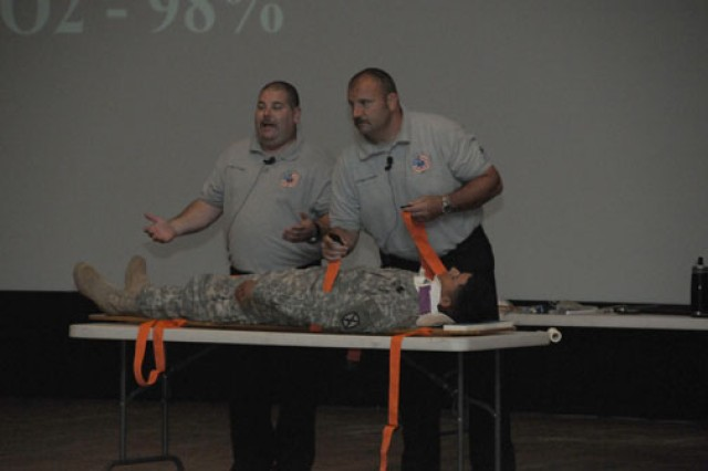 Street Smart presenters Scott McIntyre (right) and Patrick Kelly get Spc. Hector Gallego to volunteer as their accident victim in the presentation June 16.