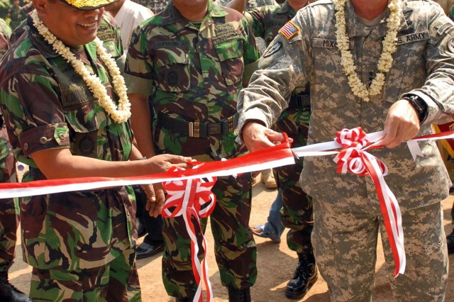 Lt. Gen. Benjamin R. Mixon, commander, U.S. Army Pacific and Tentara Nasional Indonesia- Angkatan Laut, or Indonesian Navy Vice Admiral Y. Didik Heru Purnomo, the head of general staff for the Indonesian Armed Forces, cut the ribbon at a newly build baby care clinic in a village approximately 30 minutes from Bandung, Indonesia, June 28. The ceremony marked the completion of three Humanitarian and Civic Assistance projects, which are part of Garuda Shield 2009. The projects were a joint effort between engineers from the Tentara Nasional Indonesia-Ankatan Darat, or Indonesian Army, and engineers assigned to the Utah National Guard.