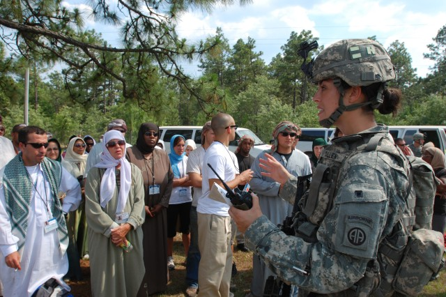1st Lt. Elise Cullen (right), a platoon leader with Headquarters Company, Brigade Special Troops Battalion, 2nd Brigade Combat Team, 82nd Airborne Division, explains processing procedures to evacuees prior to departure during a noncombatant evacuation operation conducted by the 2nd BCT at Camp Mackall, N.C. June 24-26. The exercise tested the unit's capability to deploy on short notice to help evacuate American citizens and others trapped in a war-torn foreign country.